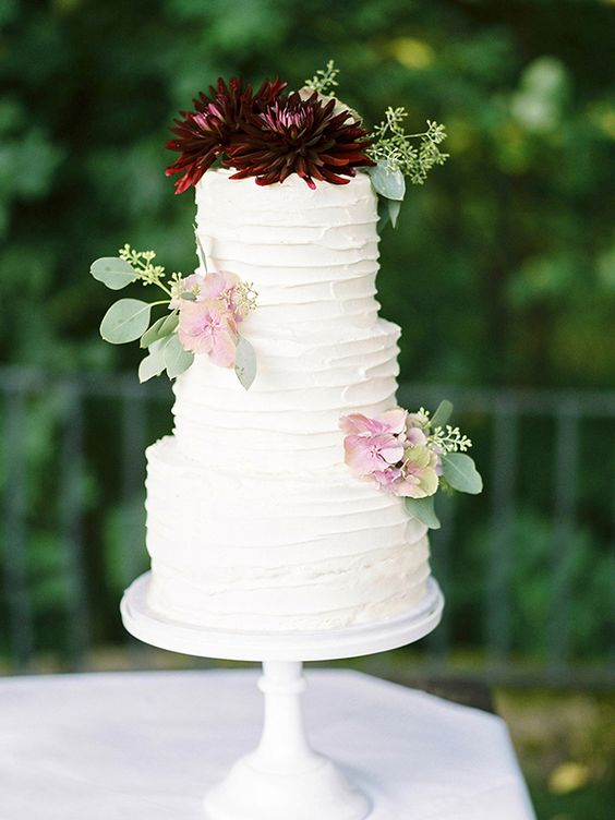 simple wedding cakes - photo by Ashley Ludaescher http://ruffledblog.com/colorful-bohemian-german-wedding