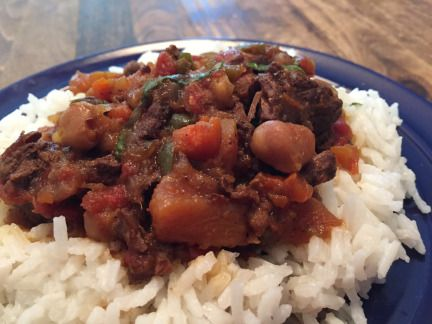 #goatvet likes this goat stew over rice - Indian in style