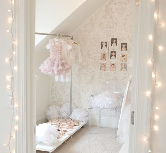 Romantic feminine shabby chic dressing room/Fortuny stenciled wall/fairy lights/DIY industiral garment rack/pink pointe shoes/Louis ghost chairs/Hello Lovely Studio