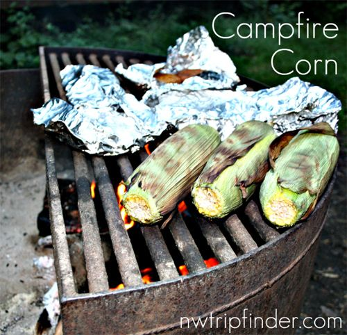 Campfire Corn recipe - Soak corn cobs in a big ziplock full of salt water for one hour, then remove and roast corn on the grate over a fire. | Get more camping tips - sign up at nwtripfinder.com