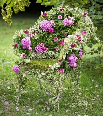 Garden Chair - Takes on life as a host for moss, vine, and roses.