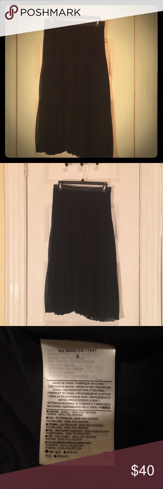 Banana Republic Pleated Midi Skirt This is such a chic skirt to pair with some kitten heels, or high-heeled pumps. Great for the office, but also an easy day-evening transition piece. Lightweight enough to transition from winter-spring. Faux leather detail around waist. Never worn, & often forgotten. Please give this skirt a new home where it will get plenty of wear. Banana Republic Skirts Midi