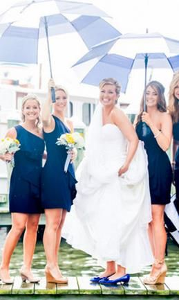 The lovely bride and her bridesmaids! Did you know it's good luck if it rains on your wedding day?! {L. Hewitt Photography}