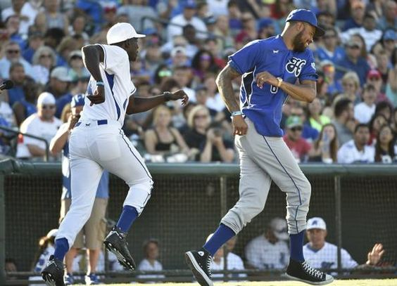Michael Finley, left, and Tyson Chandler argue about a call during the Dirk Nowitzki Heroes Celebrity Baseball Game at Dr. Pepper Ballpark in Frisco, Texas on Saturday, June 27, 2015. Michael Ainsworth/The Dallas Morning News)