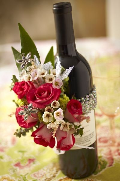 Love the flowers on the wine bottle event planning 101 for Wine bottles decorated with flowers