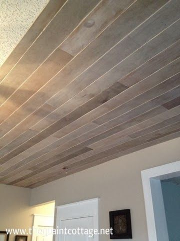 Cover a popcorn ceiling with multicolored wood slats for Faux wood ceiling planks