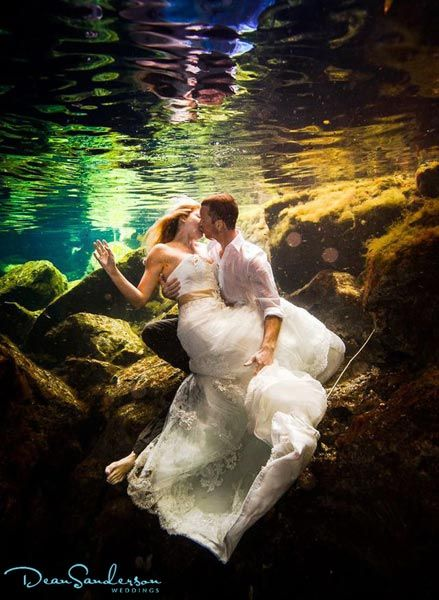 "Why We Love It: This underwater wedding photo is so dreamy!Why You Love It: Very creative, it reminds me of The Little Mermaid!"" —Raven M.:"