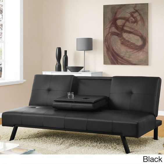 The tufted faux leather upholstery and sturdy metal legs create a perfect spot for entertaining, reading or watching TV with this Wynn futon. The fold-down tray conveniently holds drinks and snacks and can also be lifted to reveal storage underneath.