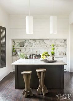 """Montclair Danby marble in a floating shelf to hover above the range and countertops, while keeping the intrinsic movement of the marble intact. In turn, the material becomes an architectural feature rather than just a surface application."""" Susan Ferrier 