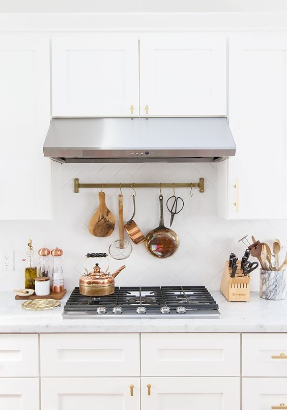 Tour a Wedding Blogger's Stunning Renovated Kitchen via @MyDomaine / Rail and hooks by Schoolhouse Electric
