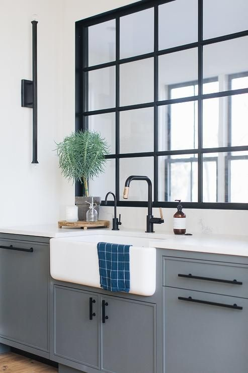Matte Black Pulls Accent Dark Blue Kitchen Cabinets Topped With A White Quartz Countertop Holding Matte Black Kitchen Dark Blue Kitchens Black Kitchen Cabinets