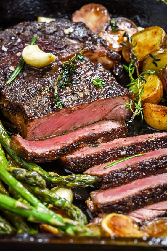 Pan-Fried Garlic Butter Steak with Crispy Potatoes and Asparagus