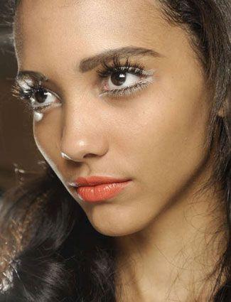 bold eyelashes and a tangerine lip wedding make up