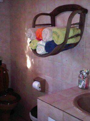 Use an old chair for towel storage in the bathroom!