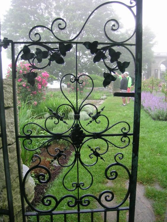 Wrought iron garden gate. by lysa fontaine
