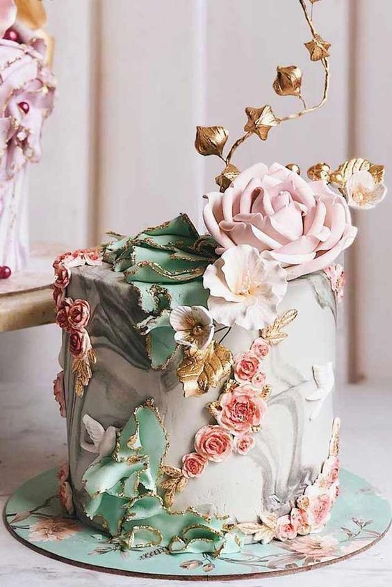 Artistic wedding cake with roses and marble effect pastel color themes