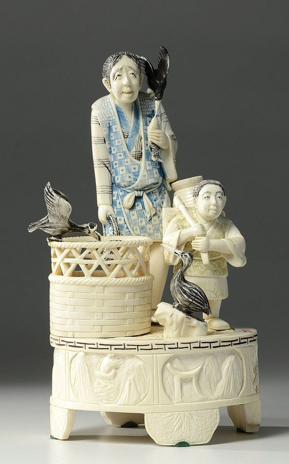 CHINESE IVORY AND VENEER FIGURAL GROUP: carved group depicting fishermen with waiting gulls, signed on base. Height 9 inches.