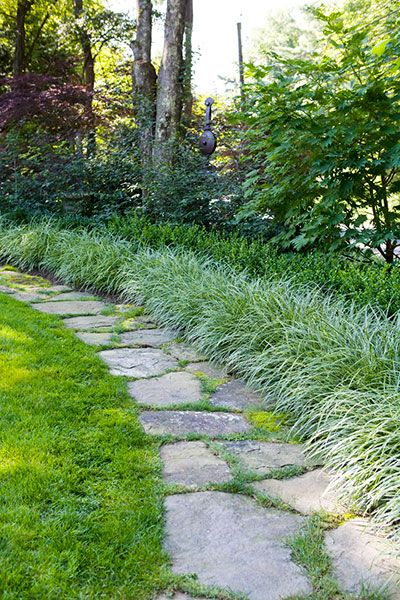 fieldstone garden path in a front yard garden retreat: