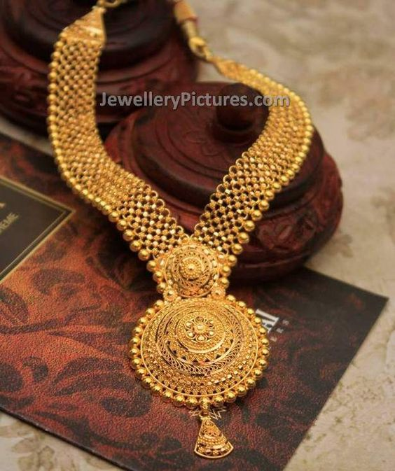 Fabulous and mind blowing gold haram designs with weight.This is a latest 22 carat jewellery with fine finishing and heavy look