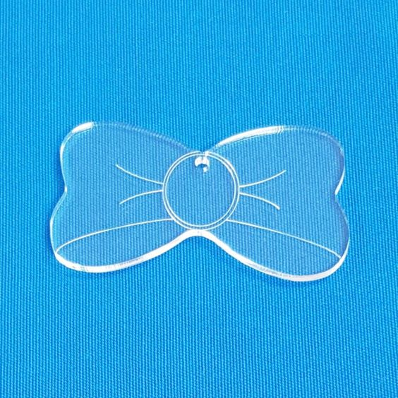 """Clear & Colors Bow Soto Acrylic Keychains 1/8"""" thick. Chose your size and favorite color. Available in 25, 50 and 100 units pack."""
