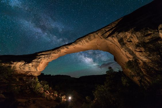 9 Romantic Park Trip Ideas: Snuggle under the stars at Natural Bridges National Monument in Utah. Host to some of the darkest night skies on the planet, stargazing here is sure to be incredible.