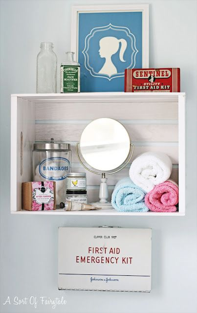 Now why shouldn't the first-aid kit serve as wall decoration in the bathroom instead of being hidden away in the back of the linen closet? via Starring Sort of a Fairytale
