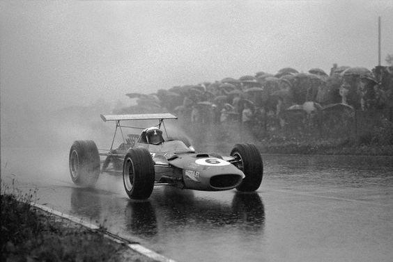 Jackie Stewart, Matra-Ford, sprays water behind his race car, German Grand Prix, Nurburgring, 1968.