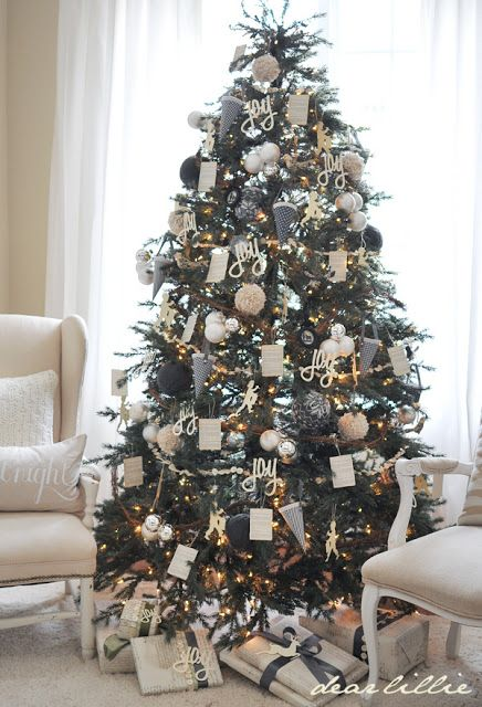 Christmas tree decorated with white and dark gray ornaments: