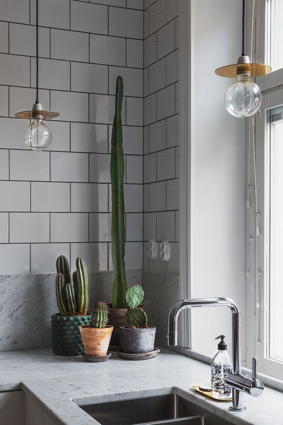 "marble with subway tiles is a nice ""opposites attracts"" kind of combo. The dark grout pulls it all together.:"