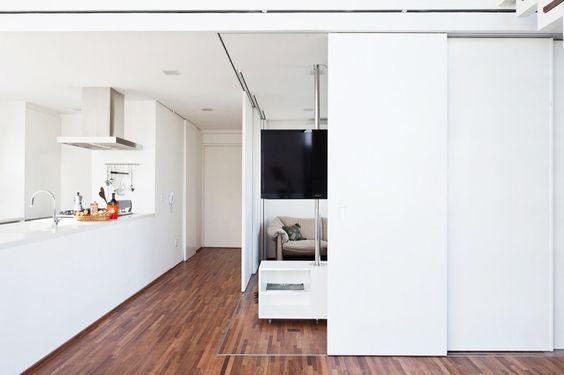 Apartment, Excellent Half Open Family Room Design Beside The Kitchen At Fidalga 727 Residnece Use Sliding Door On Darkwood Floor With White ...