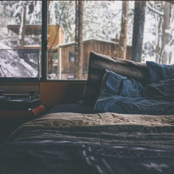 having your bed in the conservatory, watching the snow fall every evening while snuggling up to the bed.