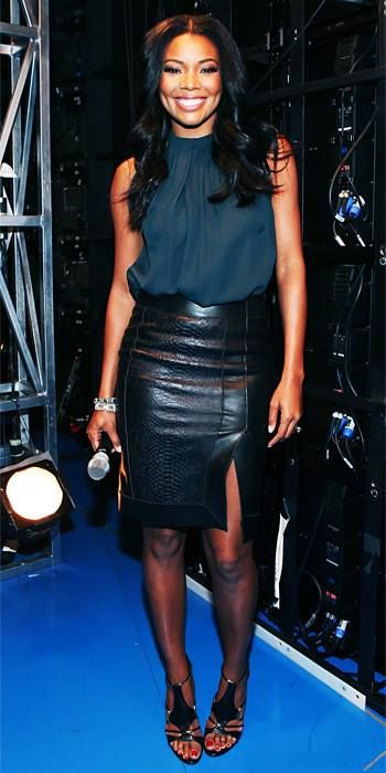 Gabrielle Union in a leather pencil skirt and a sleeveless teal blouse