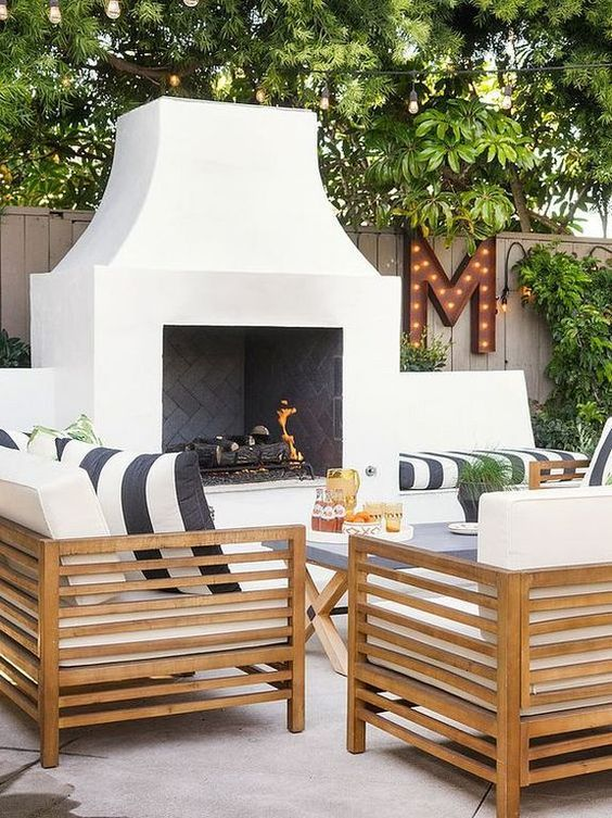 Outdoor living - patio design idea with fireplace and wood furniture
