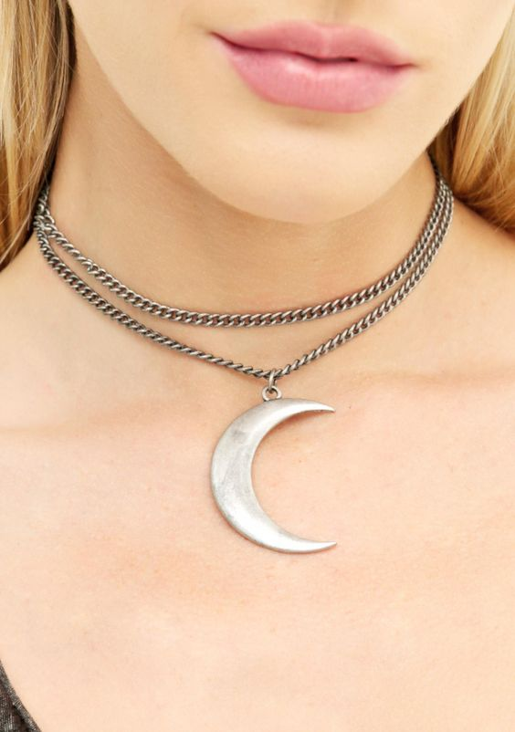 Dark Moon Necklace ...just another night time ritual to ya, bb. This gorgeous necklace features an exXxtra big silver crescent moon charm danglin' off a super long chain that ya can wrap up like a choker or let hang like a classic pendant.