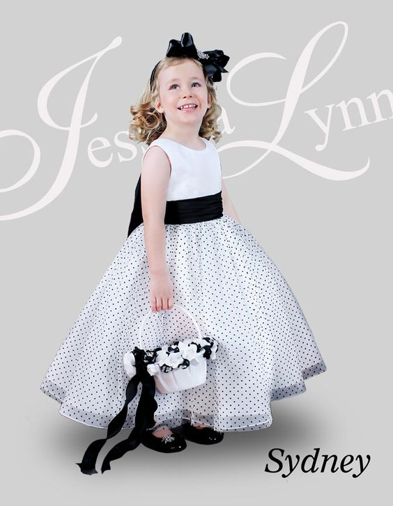 Another great flower girl from Jessica Lynn... Sydney is shown in Ivory and Black and a size 4.