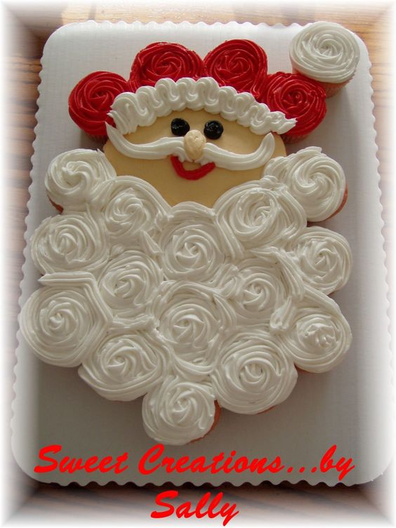 Santa Cupcake Cake - This is a CCC made of 24 cupcakes. Many thanks to The Cakerator. I copied the idea from her. I was searching the Christmas gallery back in August and thought her Santa was just adorable! This is for the preschoolers in my daughter's Pioneer Club.: