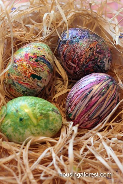 Melted Crayon Easter Eggs - (repinned)  Since we had boiled and cooled the eggs earlier, we ended up warming a few eggs in boiling water.  The rewarmed eggs were perfect for melting crayon shavings.  We also added some glitter for extra sparkle.  You can never have enough sparkle at Easter:)
