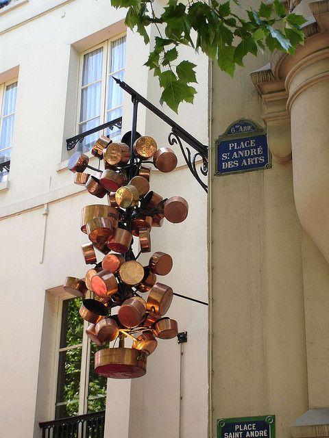 Place St André des Arts: by Julie70, via Flickr (The decoration is a symbol of Chez Clement restaurant., many branches in Paris.)