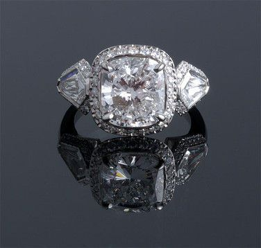 Cushion cut diamond with halo and side diamonds..umm yes please