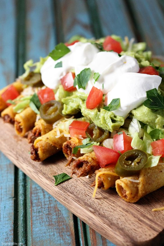 These Loaded Beef Taquitos are a fun take on nachos and are perfect for game day or any day!: