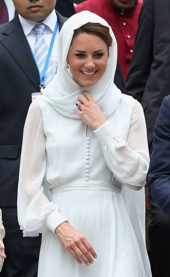 Sporting her favourite shade of eau de nil, the Duchess looked like something from another time as she arrived at the Assyakrin Mosque in Kuala Lumpur. The dress, a long-sleeved, slightly sheer incarnation by London-based brand Beulah, was an appropriately conservative choice for the occasion. Featuring a row of tiny silk-covered buttons, the dress – which is called the Blossom – was complemented by Kate's trademark LK Bennett sandals. She also wore a delicate pair of diamond earrings. Her…