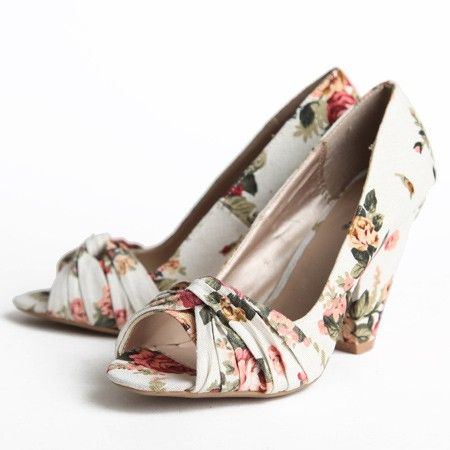 "Pembrokeshire Floral Heels In Ivory 39.99 at shopruche.com. In a simple ivory and pink floral, these ladylike peep-toe heels add detail with a twisted knot on the vamp. Wear these shoes as a statement piece in your work wardrobe or to a party.  All man-made materials 4"" heel  Slightly padded sole"