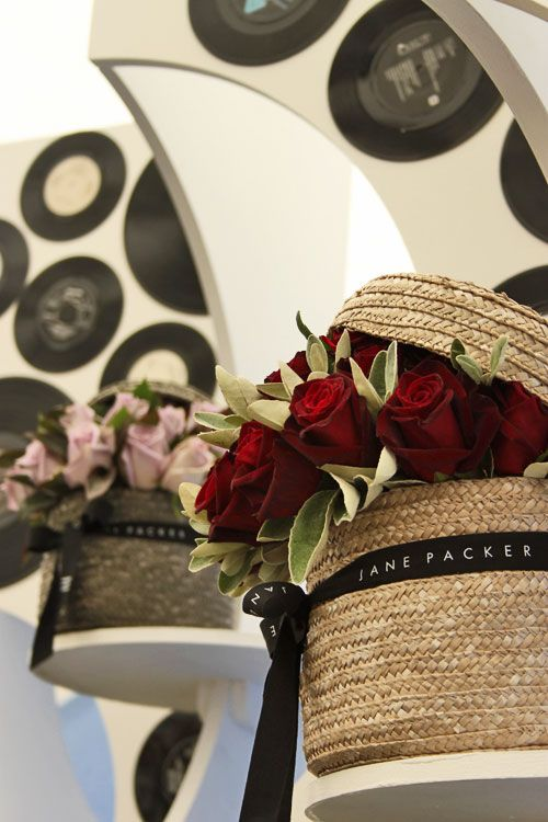 flowers coming out of hat boxes