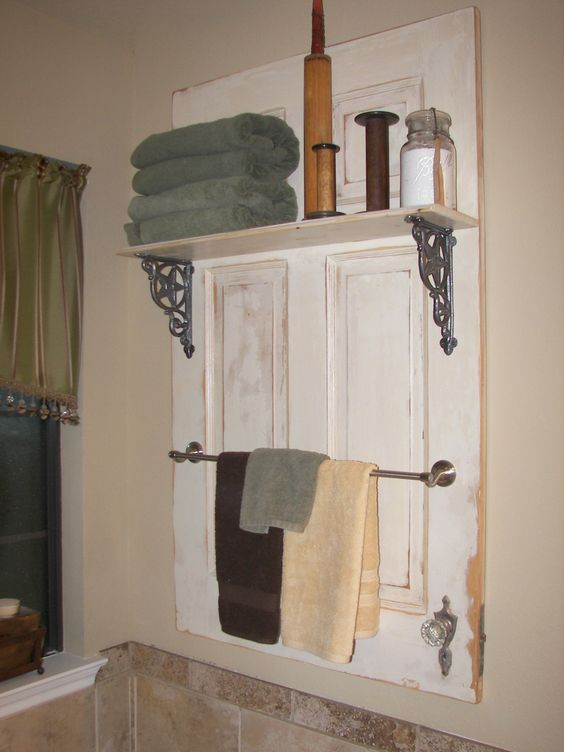 for reelz, just finished this project for my bathroom.  Old door cut down to size, add a shelf and towel bar -- Charlene