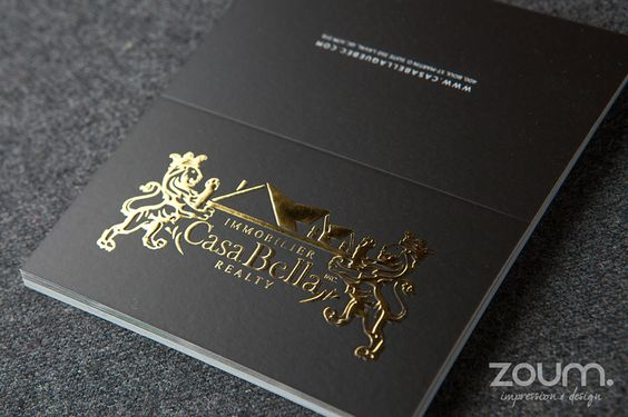 Fold over business cards with embossed gold foil printed for Zoum business cards