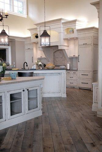 white cabinets, rustic floor, lanterns