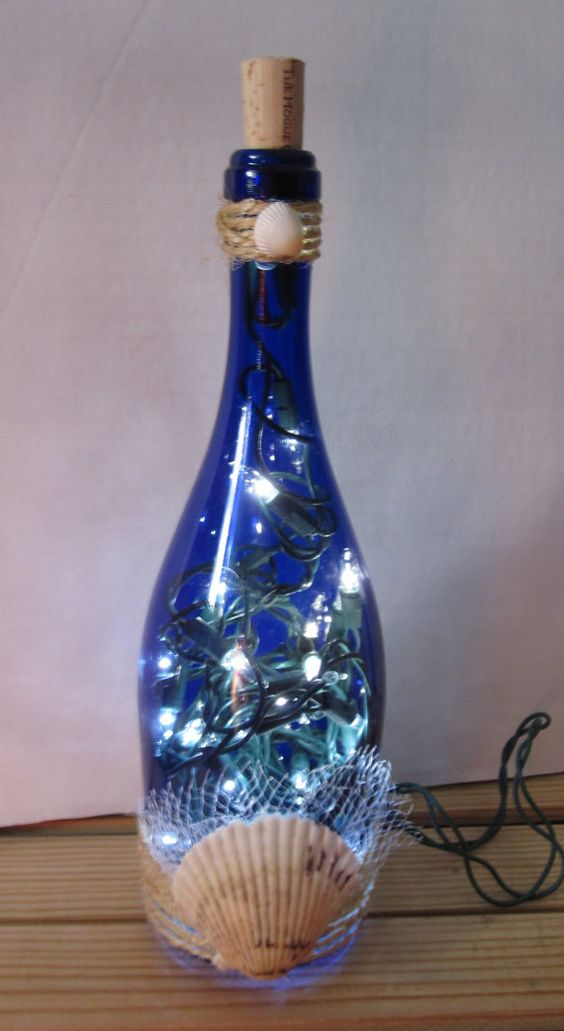 Beach tropical seashell inspired lighted bottle for in for Outdoor decorating with wine bottles