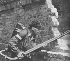 A Polish insurgent during the Warsaw Uprising armed with a K Pattern Flamethrower. Pin by Paolo Marzioli