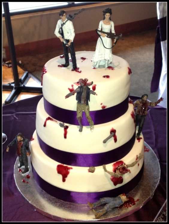 zombie wedding cake..hilarious! I want something like this to make my groom happy... or maybe those damn call of duty fellas...lol