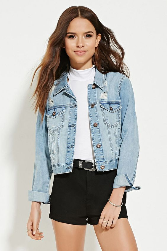 A lightweight distressed denim jacket complete with a buttoned ...